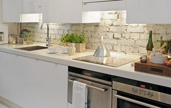 Trends in Apron for the kitchen: what material to choose for the work area